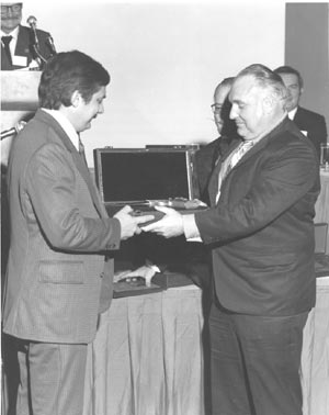 J.D. Jones receiving the Auto Mag from Harry Sanford